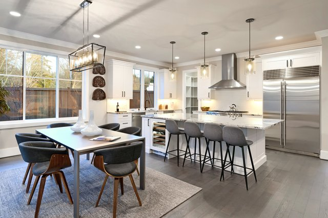 Buy a dining table that's as large as the space you can have available can accommodate