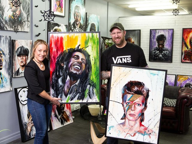 Artist Steve Wade, with manager Sarah Fearne, in the Wade Gallery and tattoo parlor, Northgate, Dewsbury