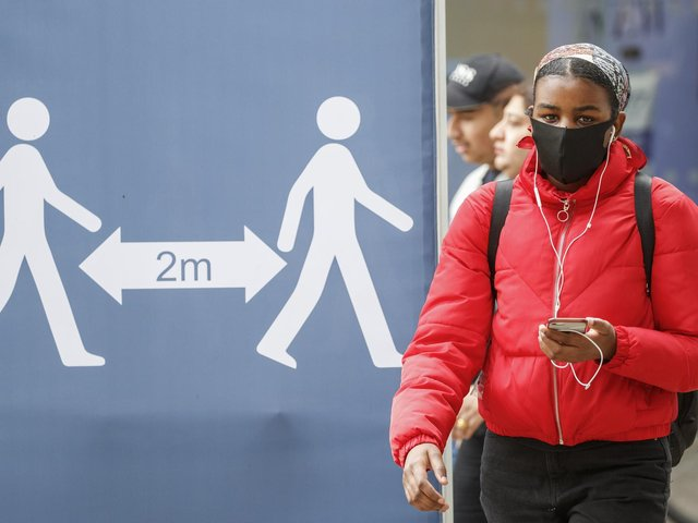 A social distancing sign in Leeds city centre, West Yorkshire, where tougher lockdown measures will be introduced locally after a rise in coronavirus infections. Photo: PA