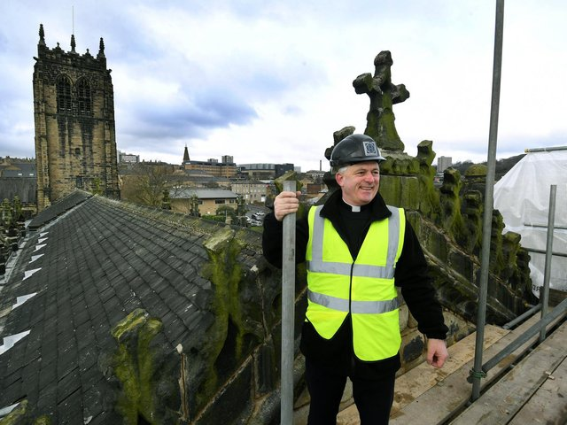 Vicar of Halifax, The Rev Canon Hilary Barber pictured on the roof of Halifax Minster