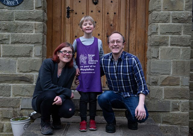 Gabriella and Carl Walker and their son Calvin in Hebden Bridge - Calvin has been doing a running challenge to raise money for Forget Me Not