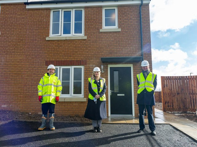 Andrew Gill, Contracts Manager, Lovell Partnerships, Tracy Brabin MP, Labour candidate for West Yorkshire mayor, Dave Procter, Chair of the Together Housing Group Board outside Plot 1, Abbey Park, Illingworth, Halifax