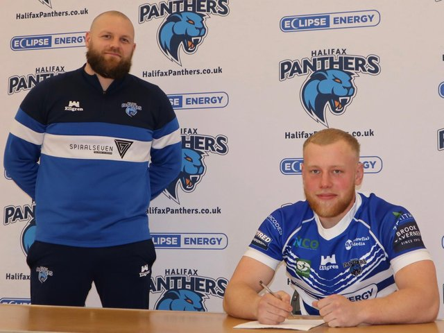 Will Calcott is pictured with head coach Simon Grix