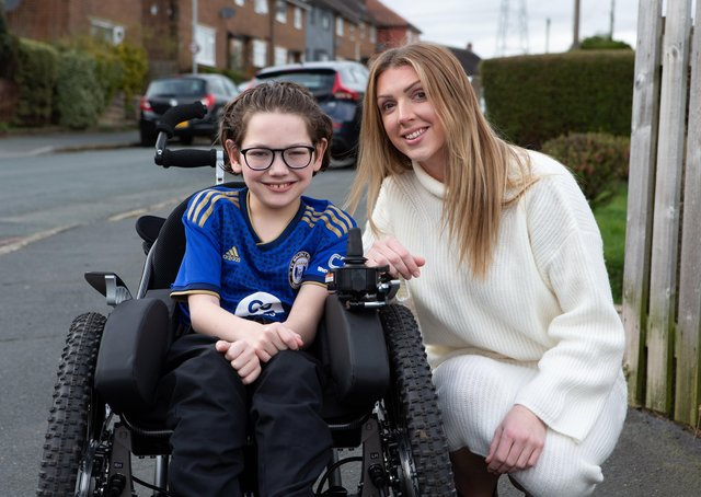 Halifax Town fan Charlie, with his mum Lucy Littley and the new wheelchair, bought with funds raised after an appeal