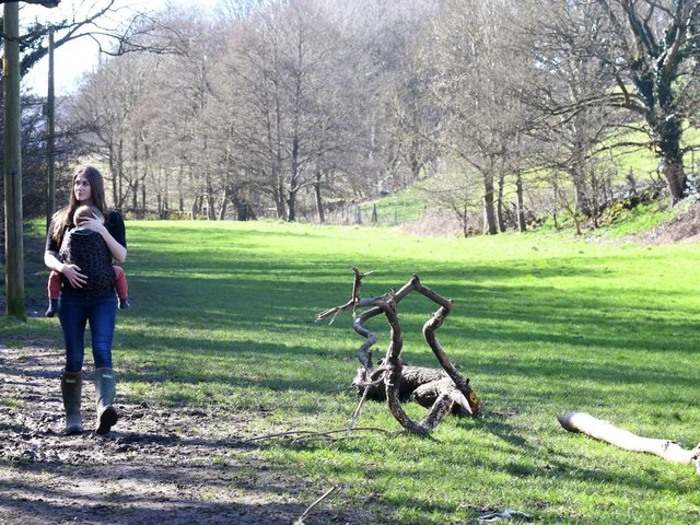 Lyndsay Ashton from Greetland, founder of the Greetland Pressure Group on a footpath by a river where hundreds of houses are proposed on the green fields behind her.,
