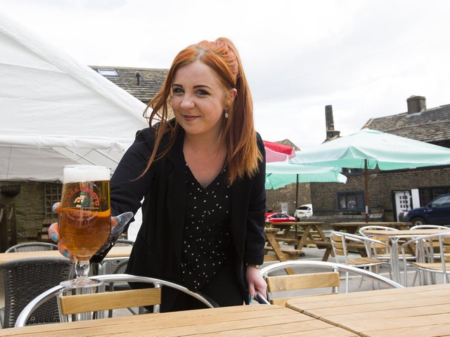 The Duke of York pub car park at Shelf has been converted into a beer garden ready to re-open. Manager Holly Branscombe is pictured.