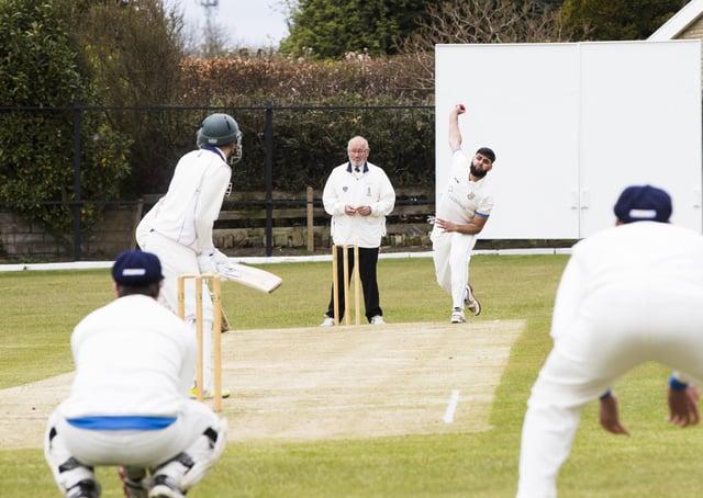 Cricket - Shelf Northowram Hedgetop v Mytholmroyd. Taufeeq Ahmed bowls for Mytholmroyd.