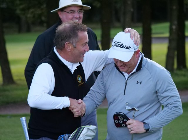 Frank Greaves, left, congratulating Lee Rowbotham after the latter holed the putt that secured victory over York and the YIDU title in September 2019.