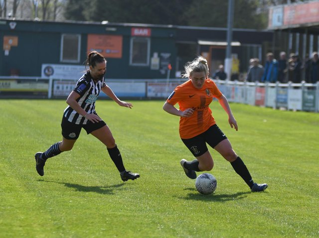 Ami Woodruff in action for Town in last season's 3-0 victory over Newcastle United in the Vitality Women's FA Cup.