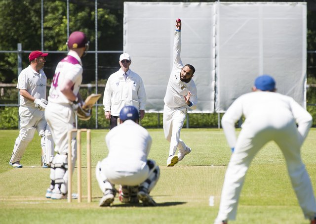 Cricket - Sowerby Bridge v Mytholmroyd. Amjid Azam bowls for Mytholmroyd.
