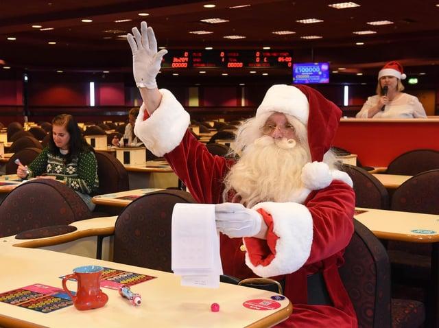 Father Christmas enjoying a game of bingo