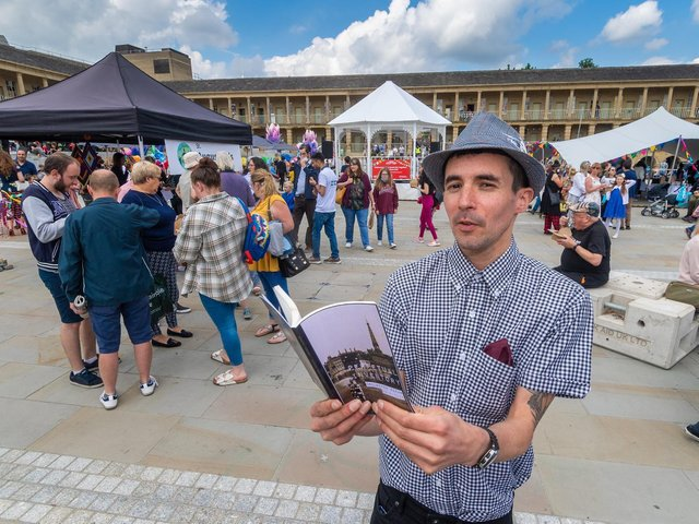 Poet Keiron Higgins reading at the Great Get Together event at the Piece Hall, Halifax