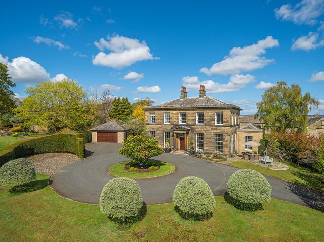The highly impressive property and grounds in Brighouse
