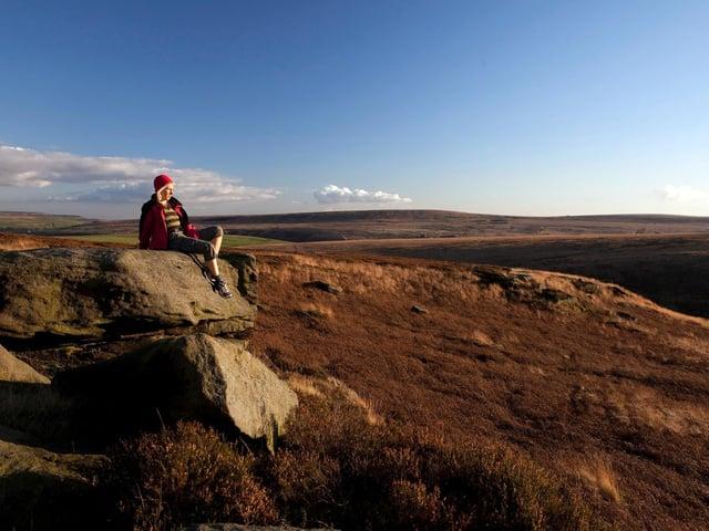 Walker takes a rest to admire the South Pennine's unique landscape. Picture: Steve Morgan.