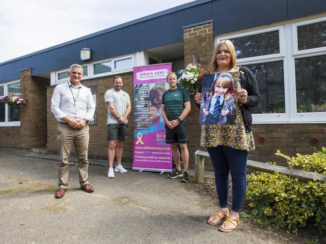 Paul Mashinter, headteacher of Carr Green Primary School with Jamie Todd and Daniel Hermann and Fifi's mum, Julia Hagreen.