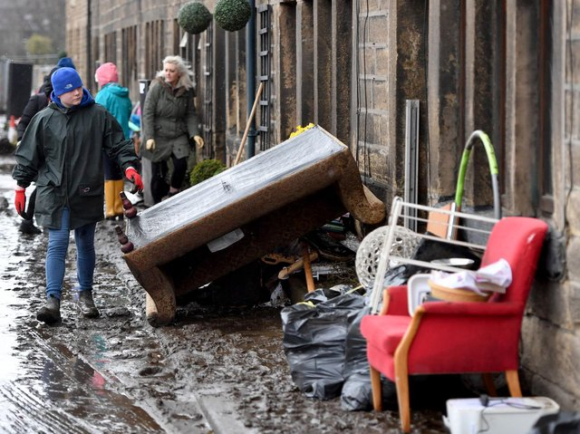 Residents begin clearing up following severe flooding beside the River Calder on February 10, 2020 in Mytholmroyd, West Yorkshire, England. (Photo by Anthony Devlin/Getty Images)