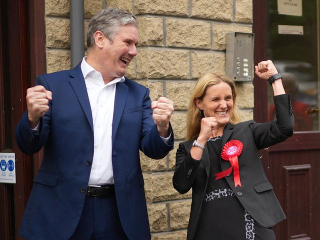 Labour leader Sir Keir Starmer celebrates with Kim Leadbeater after her victory in the Batley and Spen by-election
