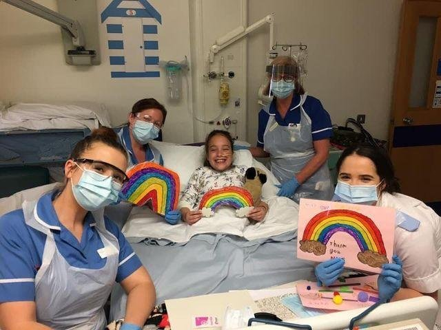 Matilda Booth from Ripponden with staff at  Leeds Children's hospital