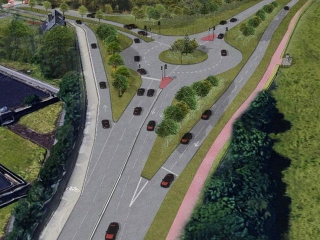 An artist's impression of how the Cooper Bridge roundabout could look after a major remodelling designed to cut congestion at the notorious bottleneck. (Image: Kirklees Council)