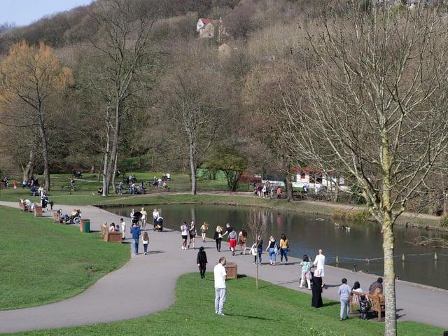 People enjoying the sun in Shibden Park