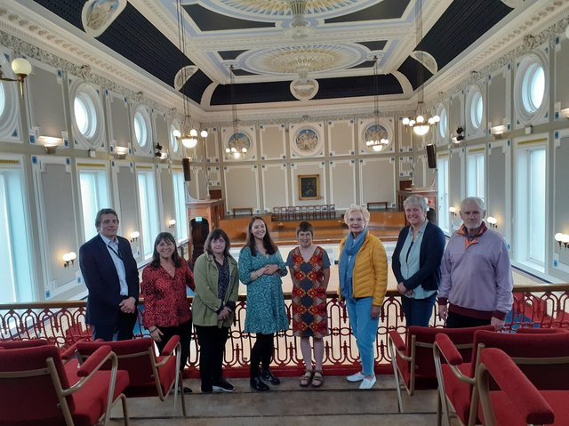 Todmorden Town Hall Working Group members in the refurbished ballroom at Todmorden Town Hall