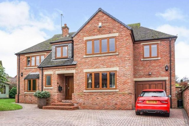 The property on Carleton Road, Pontefract, is described as a truly outstanding, individually styled and constructed detached house.